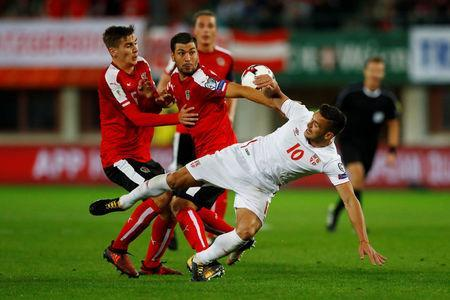 Soccer Football - 2018 World Cup Qualifications - Europe - Austria vs Serbia - Ernst Happel Stadion, Vienna, Austria - October 6, 2017 Serbia's Dusan Tadic in action with Austria's Maximilian Wober and Aleksandar Dragovic REUTERS/Leonhard Foeger