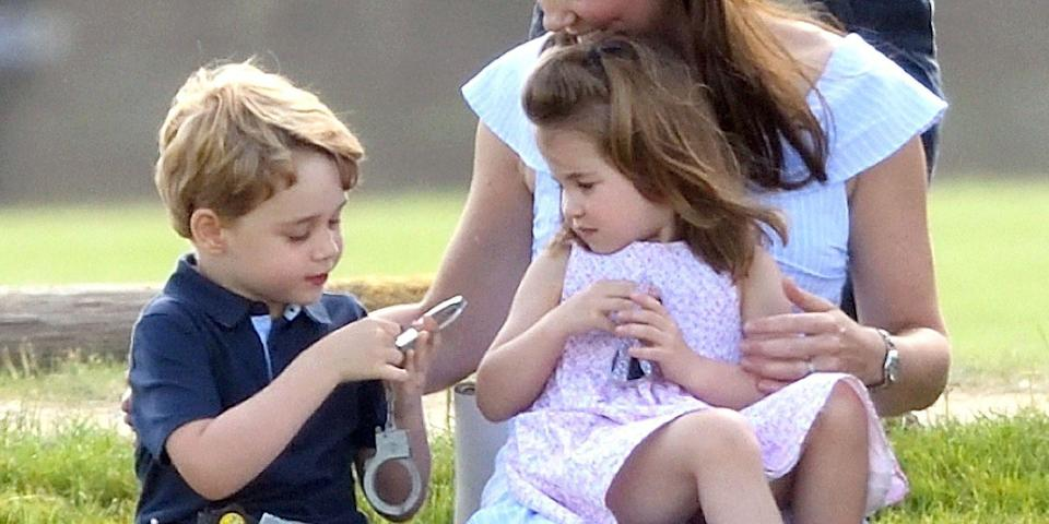 <p>Prince George and Princess Charlotte sit with the Duchess of Cambridge as they watch Prince William play in the Maserati Royal Charity Polo Trophy match. </p>