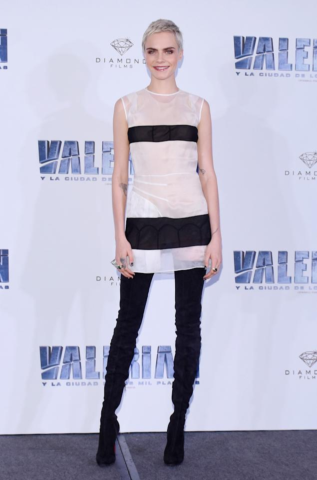 <p>The actress had already rocked a semi-sheer mini dress earlier in the day, at the photocall for the film in Mexico. This time, Parisian label Maison Margiela was behind the look. Cara finished the look with thigh-high black boots. <br /><em>[Photo: Rex]</em> </p>