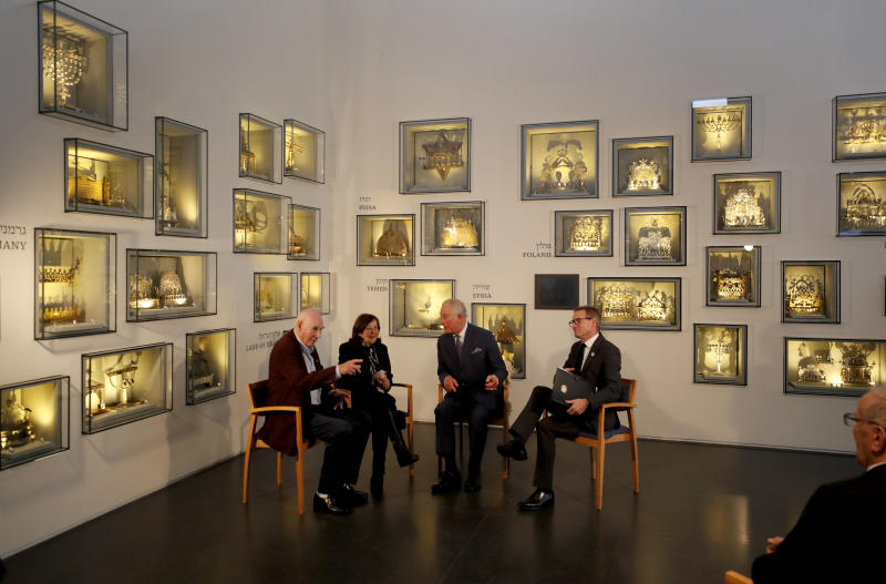 Britain's Prince Charles, second right, speaks with Holocaust survivor Marta Wise, second left, and George Shefi, left, whose mother perished at Auschwitz, during a reception at the Israel Museum in Jerusalem, Thursday, Jan. 23, 2020. (AP Photo/Frank Augstein, Pool)