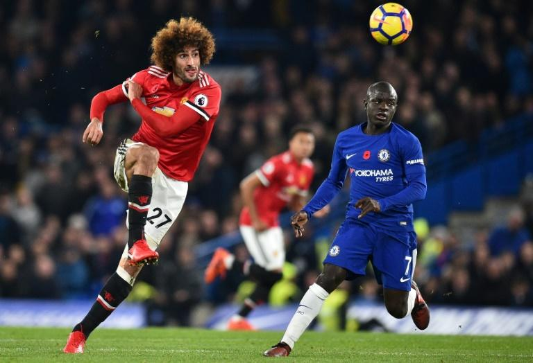 Manchester United's Marouane Fellaini (L), pictured in November 2017, alleges the football boots New Balance supplied him were poorly made and damaged his feet, thereby  hurting his athletic performance