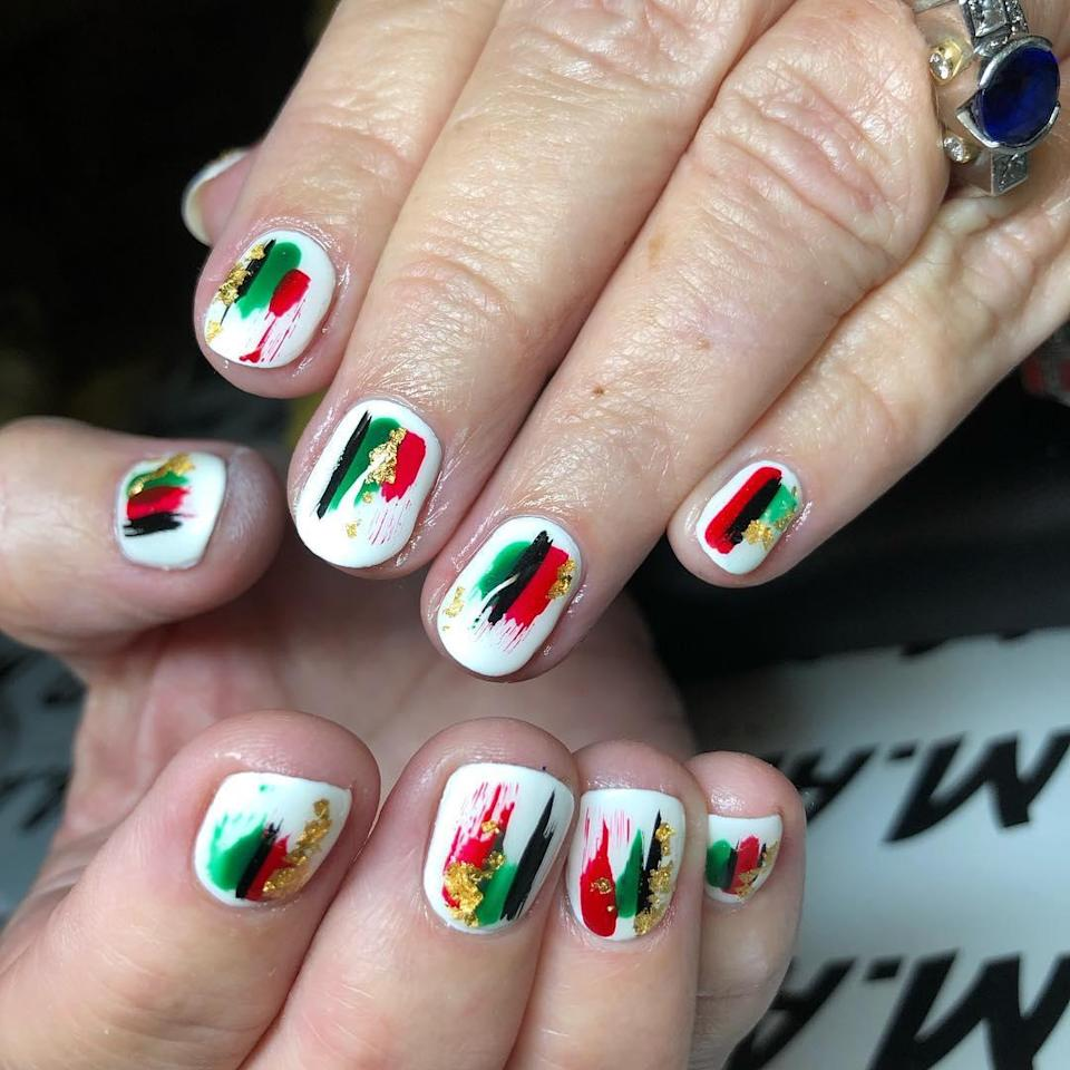 A painterly splash of red and green over white nails is just the right amount of on-theme, and a sprinkling of gold leaf takes it to the next level.