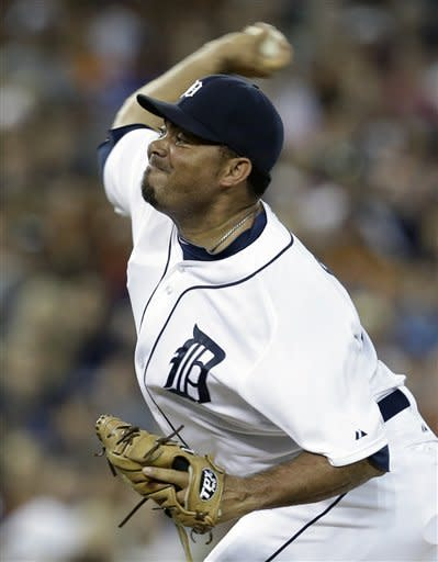 Detroit Tigers relief pitcher Joaquin Benoit throws against the Chicago White Sox in the eighth inning of a baseball game in Detroit, Friday, Aug. 31, 2012. (AP Photo/Paul Sancya)