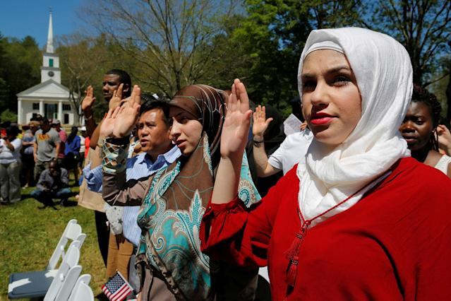 <p>Hala Alhallaq of Iraq takes the Oath of Citizenship as she and 145 others become United States citizens during a naturalization ceremony at Old Sturbridge Village in Sturbridge, Mass., July 4, 2016. (Photo: Brian Snyder/Reuters) </p>