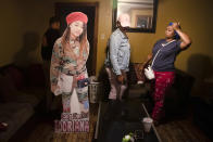 A cutout of Todriana Peters stands in her living room with her cousin Brione Rogers and mother Katrina Lambert in New Orleans, Thursday, July 8, 2021. Twelve-year-old Todriana Peters was shot and killed outside a graduation party on Memorial Day Weekend in the Lower 9th Ward neighborhood. Homicide rates in many American cities have continued to rise although not as precipitously as the double-digit jumps seen in 2020 and still below the violence of the mid-90s. (AP Photo/Sophia Germer)