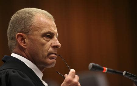 State prosecutor Gerrie Nel looks on as he cross-examines South African Olympic and Paralympic sprinter Oscar Pistorius during his trial at the North Gauteng High Court in Pretoria April 9, 2014. REUTERS/Siphiwe Sibeko