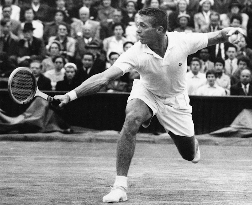 FILE - Tony Trabert makes a return to Kurt Nielson on center court at Wimbledon, in this July 1, 1955, file photo. Trabert won, 6-3, 7-5, 6-1. Trabert, a five-time Grand Slam singles champion and former No. 1 player who went on to successful careers as a Davis Cup captain, broadcaster and executive, has died. He was 90 years old. The Tennis Hall of Famer's death Wednesday night, Feb. 3, 2021, at his home in Ponte Vedra Beach, Florida, was confirmed by his daughter, Brooke Trabert Dabkowski. (AP Photo/FIle)