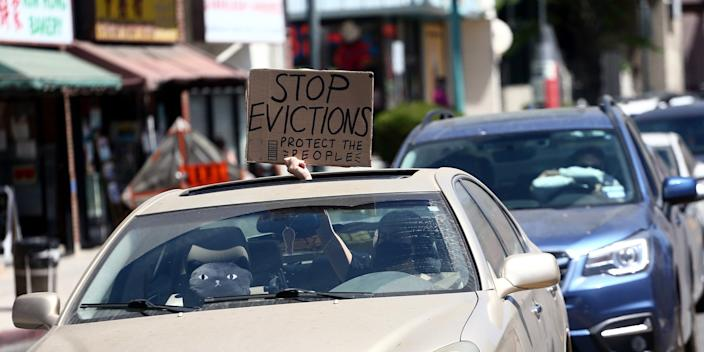 """LOS ANGELES, CALIFORNIA - AUGUST 10: Cars display signs requesting to stop evictions as protesters supporting the rent freeze gather in Chinatown on August 10, 2020 in Los Angeles, California. During the pandemic, California has passed a number of eviction protections that are under evaluation as they have started expiring. <p class=""""copyright"""">Tommaso Boddi/Getty Images</p>"""