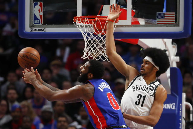 Brooklyn Nets center Jarrett Allen (31) pressures Detroit Pistons center Andre Drummond (0) in the first half of an NBA basketball game in Detroit, Saturday, Jan. 25, 2020. (AP Photo/Paul Sancya)
