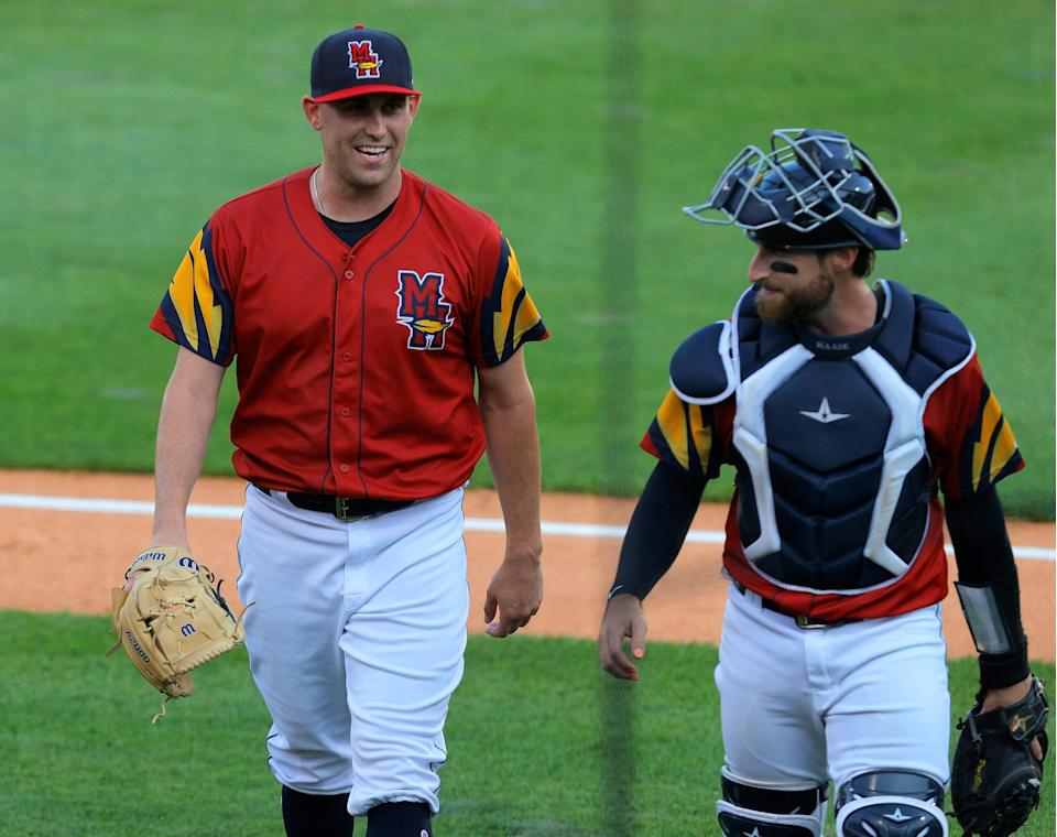 Toledo Mud Hens starting pitcher Matt Boyd has a laugh with catcher Eric Haase after the third inning in his team's game against the St. Paul Saints at Fifth Third Stadium in Toledo, Ohio on August 24, 2021.