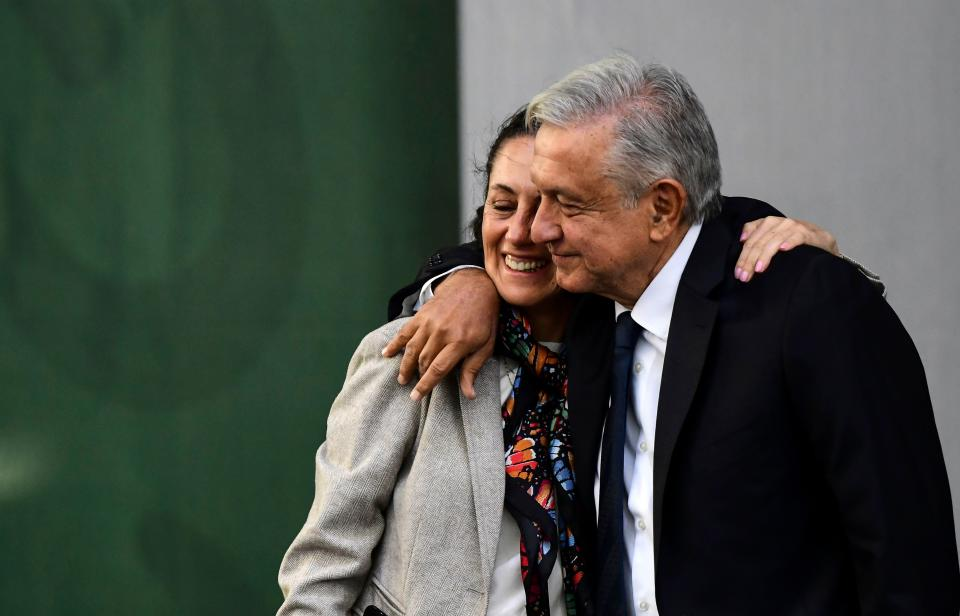 Mexican President Andres Manuel Lopez Obrador (R) hugs Mexico City's Mayor Claudia Sheinbaum after presenting his government report, at the Zocalo square in Mexico City, on July 1, 2019. - Lopez Obrador celebrates the first anniversary of his election victory with a report that ensures that economy rates will be very positive despite disappointing indicators. (Photo by RONALDO SCHEMIDT / AFP)        (Photo credit should read RONALDO SCHEMIDT/AFP via Getty Images)