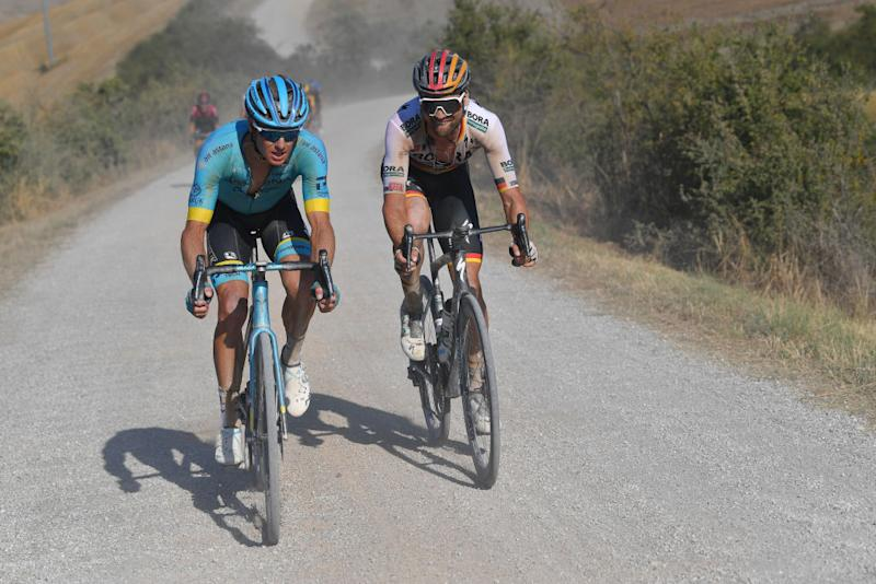 SIENA ITALY AUGUST 01 Jakob Fuglsang of Denmark and Astana Pro Team Maximilian Schachmann of Germany and Team BoraHansgrohe Dust Gravel Strokes during the Eroica 14th Strade Bianche 2020 Men a 184km race from Siena to SienaPiazza del Campo StradeBianche on August 01 2020 in Siena Italy Photo by Tim de WaeleGetty Images