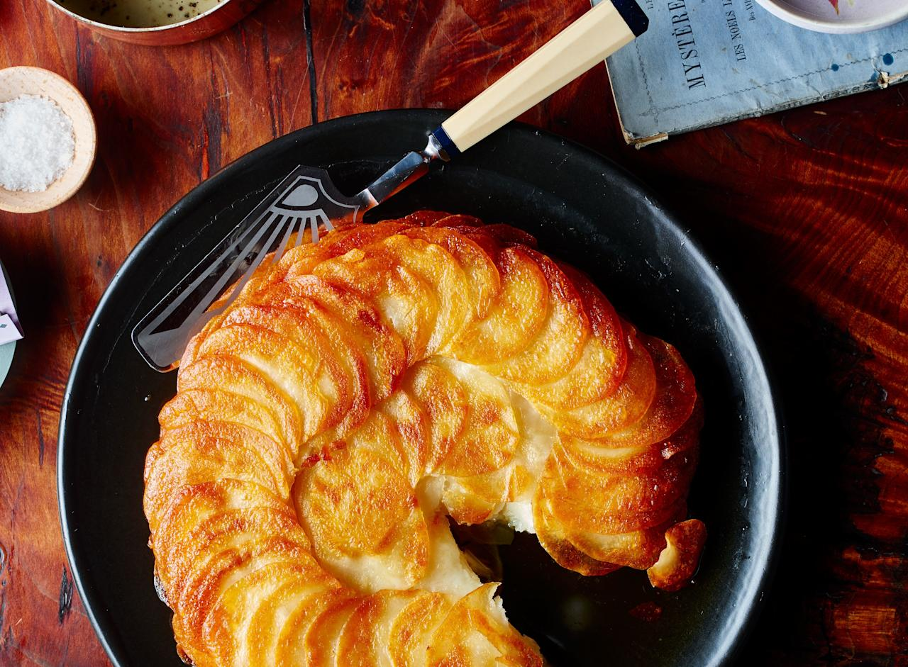"""It's not about the potatoes—it's what you do to the potatoes. In this recipe, precook them until they're tender, then dispatch clarified butter (which is less likely to burn), heat, and time to help them become their best selves. <a href=""""https://www.bonappetit.com/recipe/golden-potato-cake?mbid=synd_yahoo_rss"""">See recipe.</a>"""