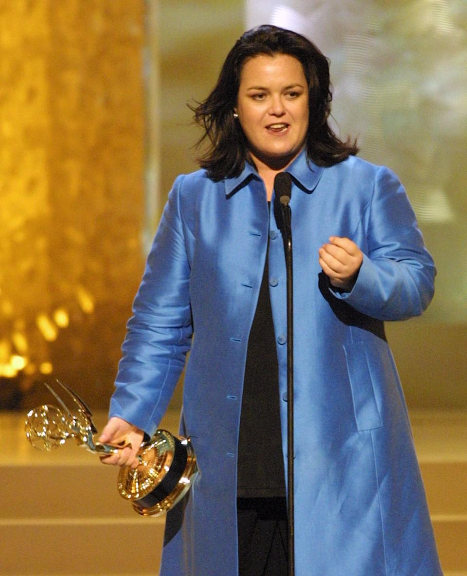 "Co-winner of the award for best talk show host, Rosie O'Donnell, accepts her Emmy at the 2001 Daytime Emmy Awards at New York's Radio City Music Hall, Friday, May 18, 2001. ""Who Wants to be a Millionaire"" host Regis Philbin and O'Donnell shared the award. (AP Photo/Stuart Ramson)"