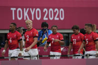 Players from Britain leave the pitch after their men's rugby sevens match against Japan at the 2020 Summer Olympics, Monday, July 26, 2021 in Tokyo, Japan. (AP Photo/Shuji Kajiyama)