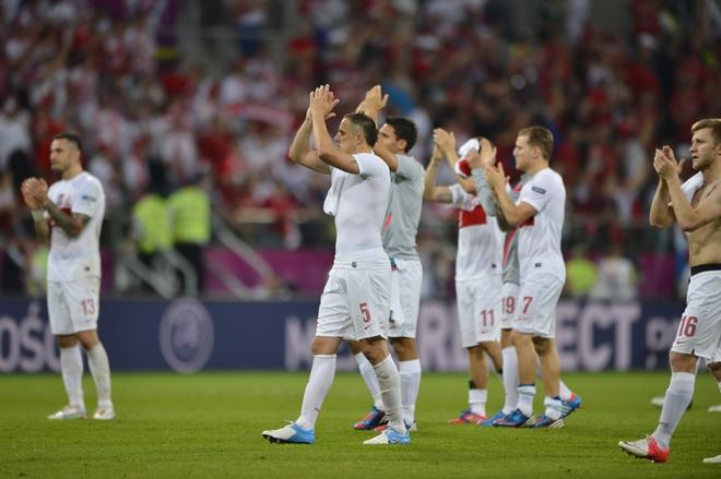 Polish players react after loosing during the Euro 2012 championships football match between the Czech Republic and Poland on June 16, 2012 at the Municipal  Stadium in Wroclaw. AFP PHOTO / FABRICE COFFRINIFABRICE COFFRINI/AFP/GettyImages