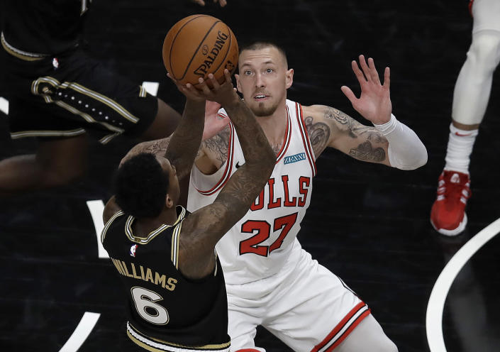Chicago Bulls' Daniel Theis, right, guards Atlanta Hawks' Lou Williams (6) during the first half of an NBA basketball game Friday, April 9, 2021, in Atlanta. (AP Photo/Ben Margot)