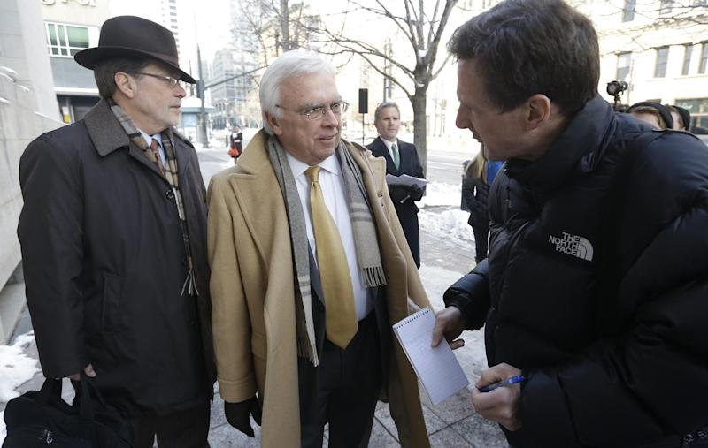 """Utah Assistant Attorney General Jerrold Jensen, center, speaks with a reporter before entering the Federal court in Salt Lake City, Thursday, Jan. 17, 2013, for a hearing in the """"Sister Wives"""" lawsuit challenging Utah's bigamy laws. (AP Photo/Rick Bowmer)"""