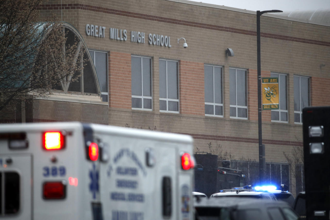 Deputies, federal agents and rescue personnel, converge on Great Mills High School, the scene of a shooting, Tuesday morning, March 20, 2018 in Great Mills, Md. The shooting left at least three people injured including the shooter. (AP Photo/Alex Brandon )