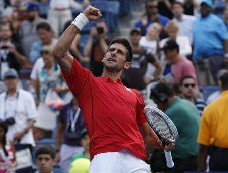 Novak Djokovic of Serbia celebrates after defeating Marcel Granollers of Spain at the U.S. Open tennis championships in New York September 3, 2013. REUTERS/Mike Segar