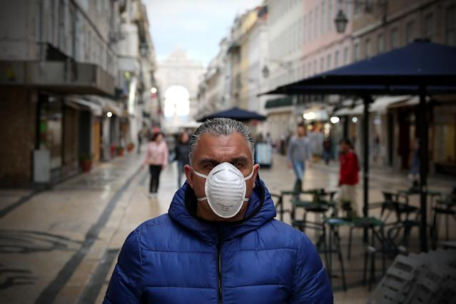 A men wearing a mask is pictured in downtown Lisbon, Portugal. There are 785 confirmed cases of COVID-19 in the country. (Getty Images)