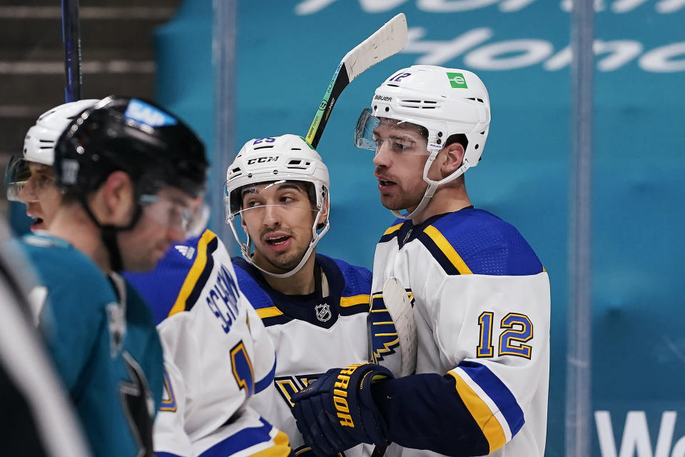 St. Louis Blues left wing Zach Michael Sanford (12) is congratulated by Jordan Kyrou (25) after scoring a goal against the San Jose Sharks during the second period of an NHL hockey game in San Jose, Calif., Saturday, Feb, 27, 2021. (AP Photo/Tony Avelar)