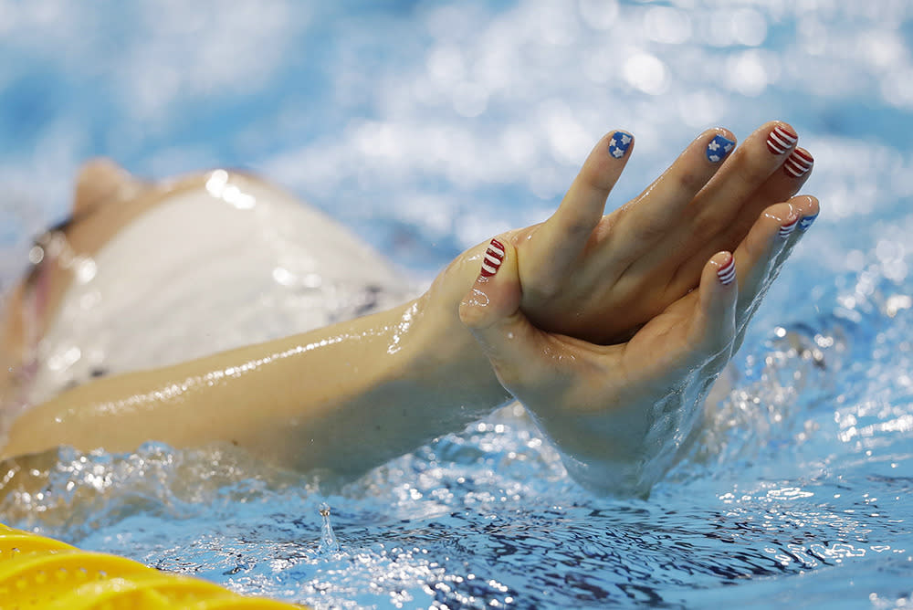 <p>United States' Missy Franklin, with her nails painted the colors of United States flag, swims during a training session at the 2016 Summer Olympics, Aug. 4, 2016, in Rio de Janeiro. (Photo: AP)</p>