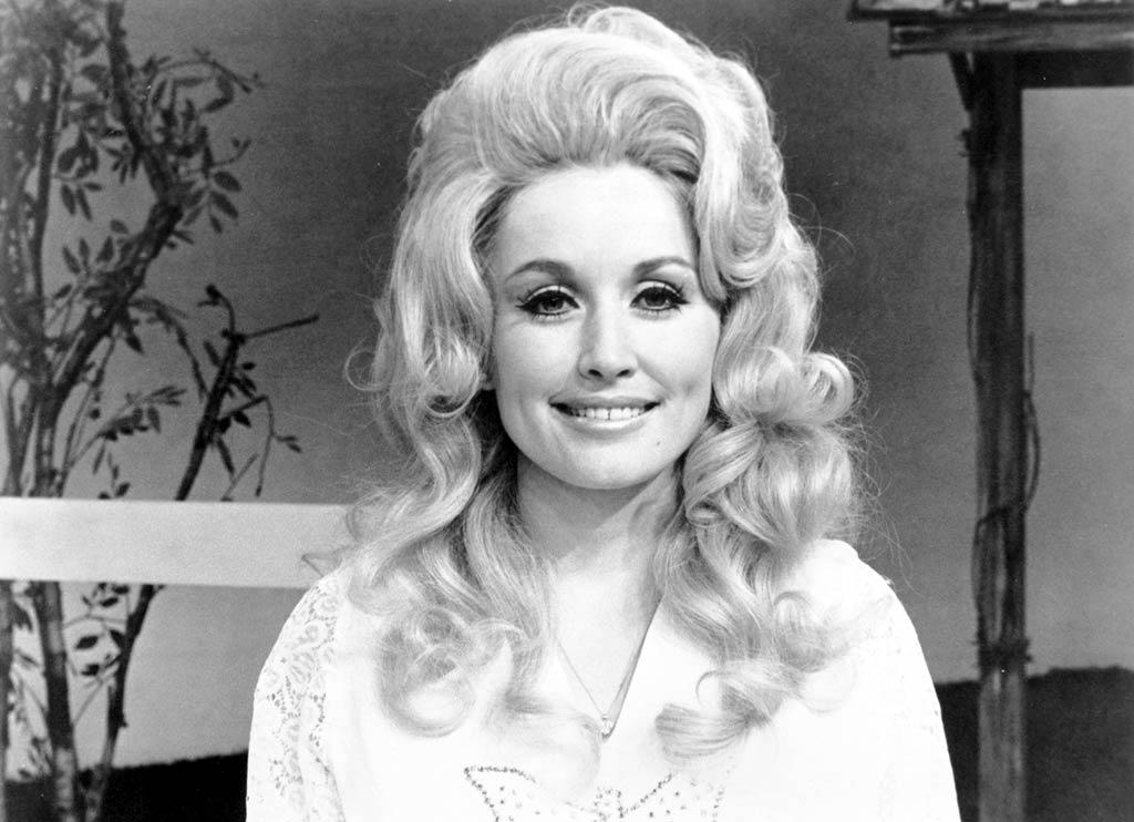 """<b>1972:</b> The rising star (who released two solo albums and performed with partner Porter Wagoner) had already adopted her trademark whipped cream wigs and frosty makeup.   <a href=""""http://www.instyle.com/instyle/package/transformations/photos/0,,20290120_1049222_852783,00.html?xid=omg-barrymore-trans?yahoo=yes"""" target=""""new"""">Drew Barrymore Through the Years</a> Michael Ochs Archives/<a href=""""http://www.gettyimages.com/"""" target=""""new"""">GettyImages.com</a> - 1972"""