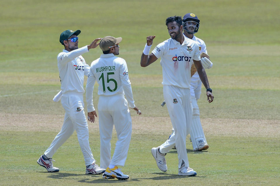 Bangladeshi bowler Ebadat Hossain, right, celebrates after dismissing Sri Lanka's Pathum Nisanaka during the fifth day of the first test cricket match between Sri Lanka and Bangladesh in Pallekele, Sri Lanka, Sunday, April 25, 2021. (AP Photo/Sameera Peiris)