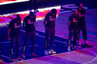 "Members of the Minnesota Timberwolves, pictured, and the Brooklyn Nets wear T-shirts that read ""With liberty and justice for all"" as a tribute to Daunte Wright, before an NBA basketball game Tuesday, April 13, 2021, in Minneapolis. Wright was fatally shot during a traffic stop in Brooklyn Center, Minn. (AP Photo/Craig Lassig)"