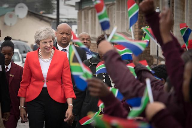 Theresa May meets students and staff at I.D. Mkize Secondary School in Cape Town (PA Images)