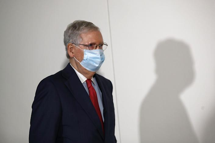 Senate Majority Leader Mitch McConnell wears a face mask used to protect against the spread of the new coronavirus as he attends a press conference after meeting with Senate Republicans on 19 May, 2020: AP Photo/Patrick Semansky