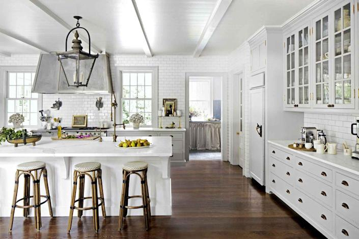 <p>Against a light walls, cabinets, and countertops, choose a dark floor stain to really ground the space and add some much-needed contrast.</p>