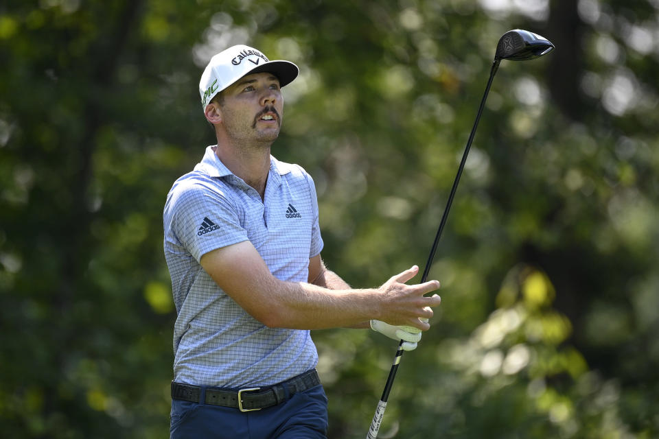 Sam Burns watches his tee shot on the fifth hole during the first round of the BMW Championship golf tournament, Thursday, Aug. 26, 2021, at Caves Valley Golf Club in Owings Mills, Md. (AP Photo/Nick Wass)