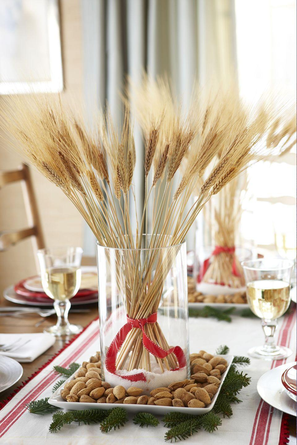 "<p>Store stalks of wheat upright in cylinder vases by layering the bottom with sugar or sand. For a rustic touch, place them on trays filled with almonds or walnuts. </p><p><a class=""link rapid-noclick-resp"" href=""https://www.amazon.com/Pomeat-Natural-Kitchen-Wedding-Decoration/dp/B07XDKKF1V/ref=sr_1_6?dchild=1&keywords=wheat+stalks&qid=1595447165&s=home-garden&sr=1-6&tag=syn-yahoo-20&ascsubtag=%5Bartid%7C10055.g.1681%5Bsrc%7Cyahoo-us"" rel=""nofollow noopener"" target=""_blank"" data-ylk=""slk:SHOP WHEAT"">SHOP WHEAT</a></p>"