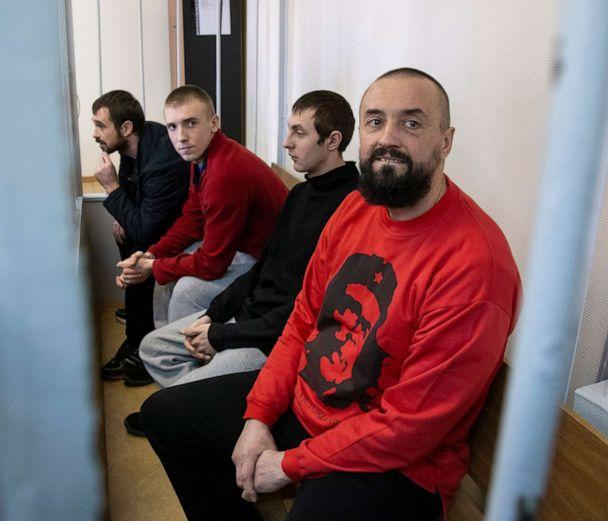 PHOTO:In this April 17, 2019 file photo Ukrainian sailors sit in a cage in a courtroom in Moscow. (Alexander Zemlianichenko/AP, FILE)