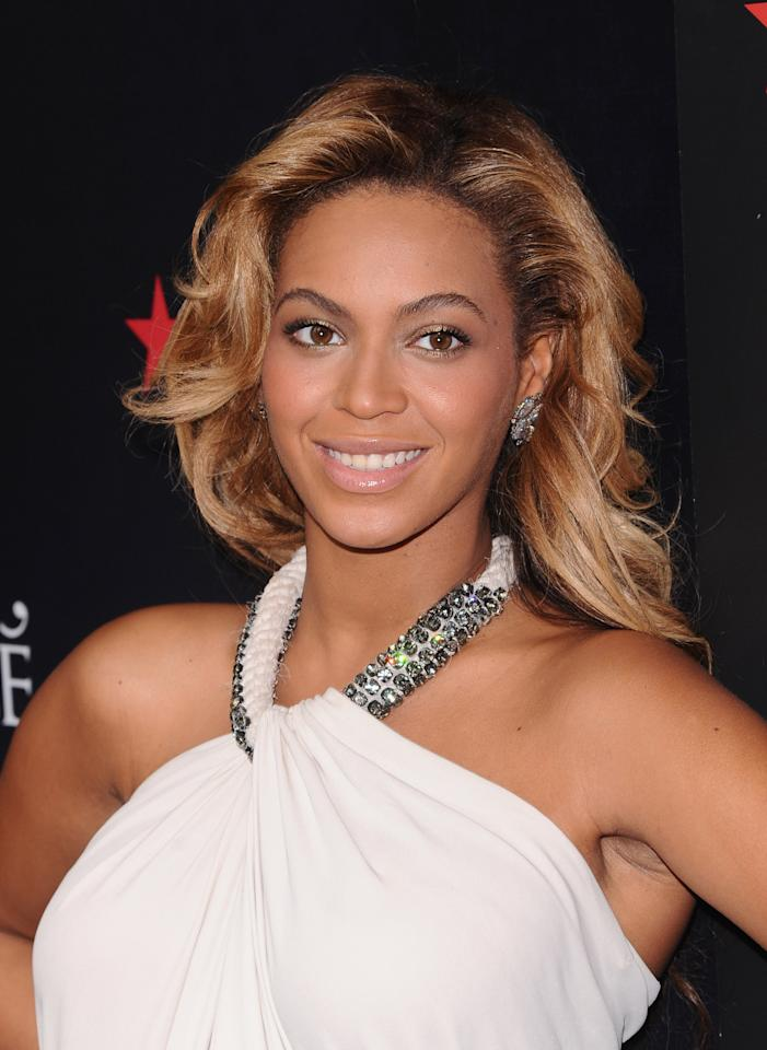 "FILE - In this Sept. 22, 2011 file photo, singer Beyonce Knowles makes an appearance at Macy's Herald Square to promote her new fragrance 'Pulse' in New York. People magazine is naming Beyonce as the World's Most Beautiful Woman for 2012. The 30-year-old singer tops the magazine's annual list of the ""World's Most Beautiful"" in a special double issue. The announcement was made Wednesday, April 25, 2012. (AP Photo/Peter Kramer)"