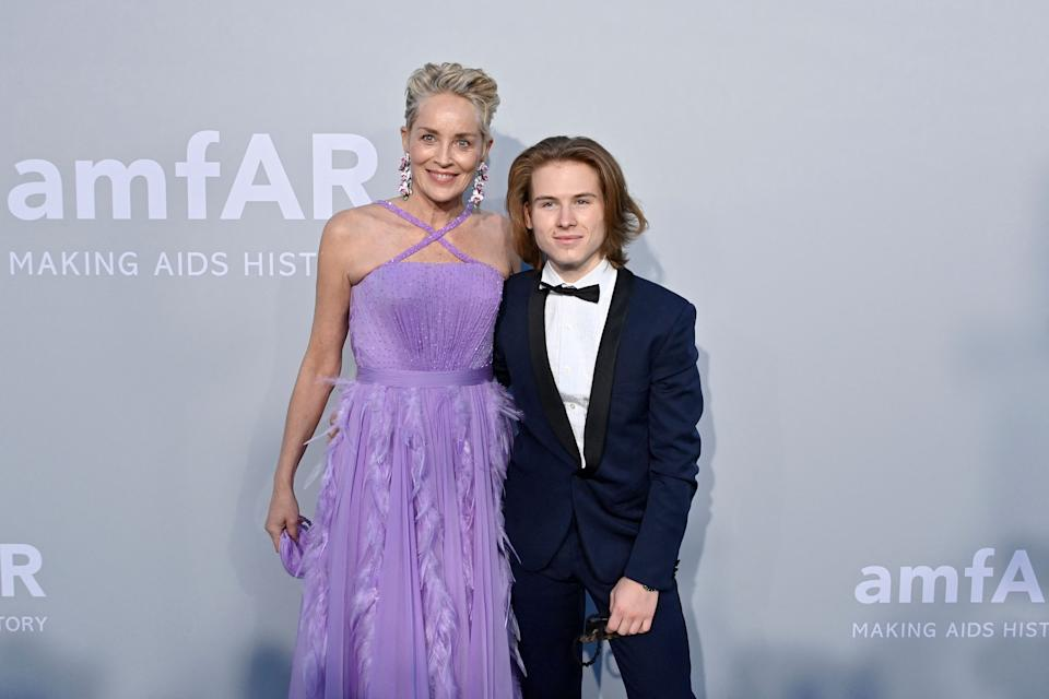 US actress Sharon Stone (L) and her son Roan Joseph Bronstein arrive on July 16, 2021 to attend the amfAR 27th Annual Cinema Against AIDS gala at the Villa Eilenroc in Cap d'Antibes, southern France, on the sidelines of the 74th Cannes Film Festival. (Photo by John MACDOUGALL / AFP) (Photo by JOHN MACDOUGALL/AFP via Getty Images)