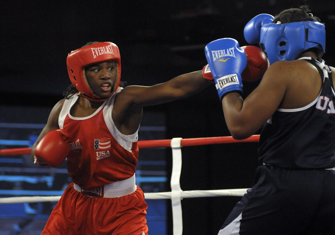 Claressa Shields, left, and Tika Hemingway battle during a middleweight boxing match at the U.S. Olympic women's boxing team trials on Saturday, Feb. 18, 2012. Shields won. (AP Photo/Jed Conklin)