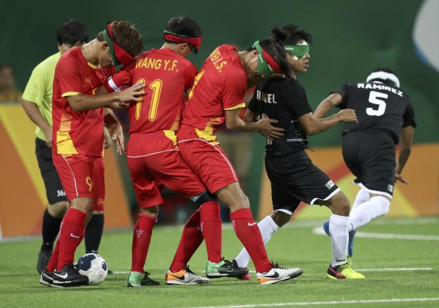 2016 Rio Paralympics - Football Soccer - Men's 5-a-side Preliminaries Pool B - China v Mexico - Olympic Tennis Centre - Rio de Janeiro, Brazil - 11/09/2016. From left, Wang Zhoubin, Wang Yafeng and Wei Jiansen (CHN) of China in action with Francisco Rangel and Marco Ramirez (MEX) of Mexico.REUTERS/Ueslei Marcelino FOR EDITORIAL USE ONLY, NOT FOR SALE FOR MARKETING OR ADVERTISING CAMPAIGNS.