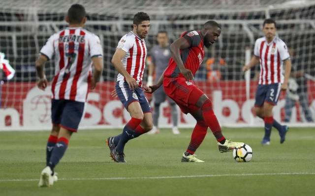 Toronto FC's Jozy Altidore, second right, fights for the ball with Chivas' Jair Pereira, second left, during the CONCACAF Champions League final soccer match in Guadalajara, Mexico, Wednesday, 25, 2018. (AP Photo/Eduardo Verdugo)