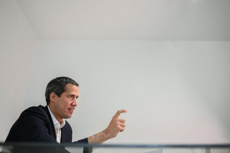 Venezuela opposition leader Juan Guaido is confident he would beat President Nicolas Maduro in an election (AFP/Federico PARRA)