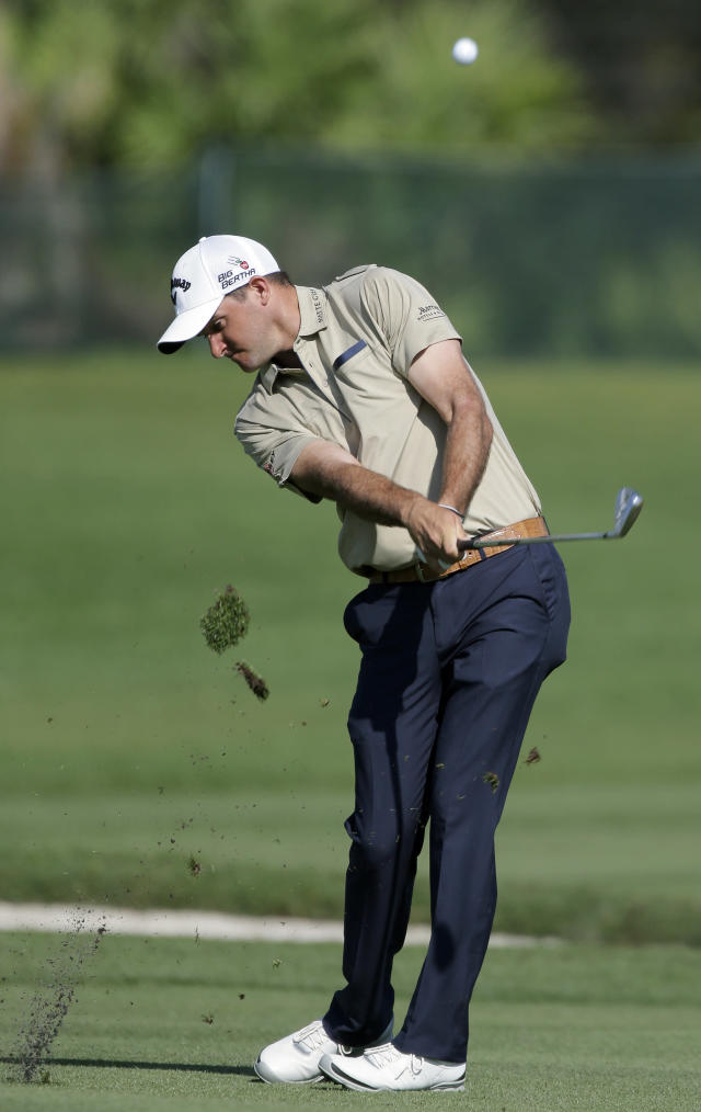 Sam Saunders takes a divot as he hits his second shot from the fifth fairway during the second round of the Arnold Palmer Invitational golf tournament at Bay Hill Friday, March 21, 2014, in Orlando, Fla. (AP Photo/Chris O'Meara)