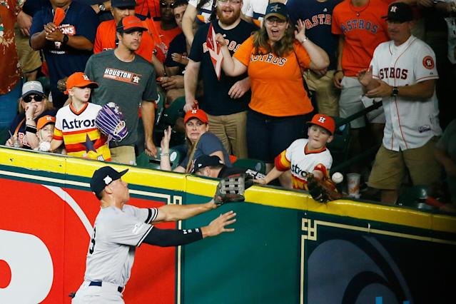 Carson Riley tries to catch Carlos Correa's homer in Game 2 of the ALCS. (Getty Images)