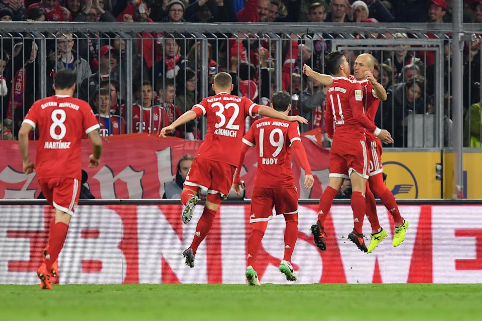 James Rodriguez and Arjen Robben celebrate Bayern Munich's first goal against RB Leipzig. (Getty Images)