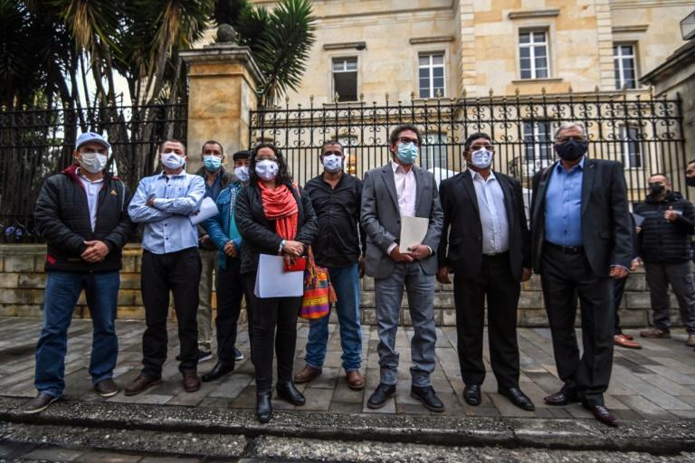 Former guerrilla leaders and current members of the Common Alternative Revolutionary Force (FARC) political party pose outside the presidential palace in Bogota, Colombia, before meeting with President Ivan Duque, in November 2020