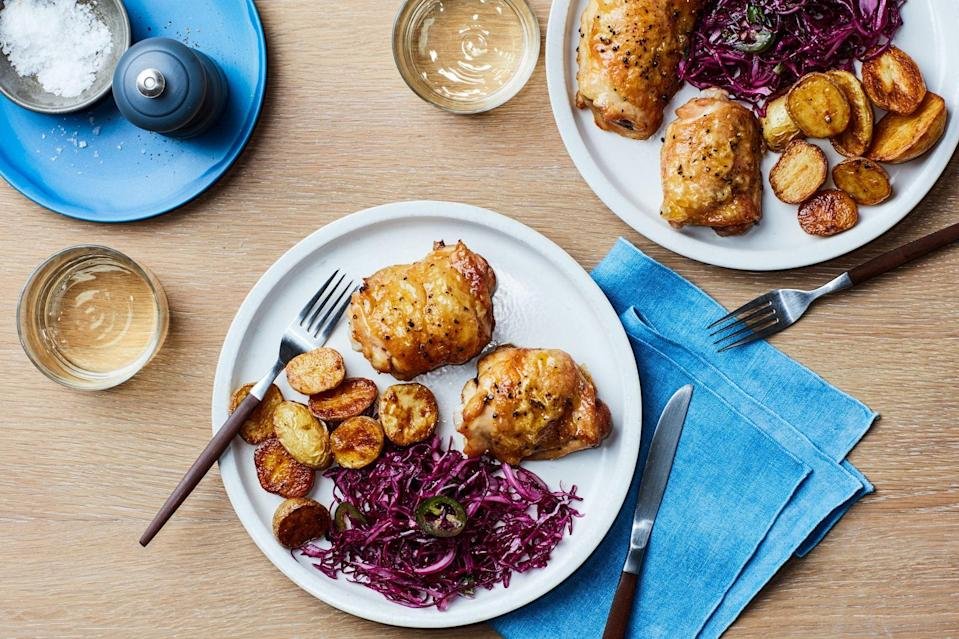 """Developed for our <a href=""""http://www.epicurious.com/expert-advice/cook90-90-meals-recipes-tips-articles-package?mbid=synd_yahoo_rss"""" rel=""""nofollow noopener"""" target=""""_blank"""" data-ylk=""""slk:#cook90 initiative"""" class=""""link rapid-noclick-resp"""">#cook90 initiative</a>, these cumin-spiced chicken thighs and potatoes are balanced by a zippy alternative to coleslaw. The recipe serves 4 tonight, or 2 with leftovers to make <a href=""""http://www.epicurious.com/recipes/food/views/nextover-chicken-tacos-with-quick-refried-beans?mbid=synd_yahoo_rss"""" rel=""""nofollow noopener"""" target=""""_blank"""" data-ylk=""""slk:&quot;Nextover&quot; Chicken Tacos with Quick Refried Beans"""" class=""""link rapid-noclick-resp"""">""""Nextover"""" Chicken Tacos with Quick Refried Beans</a> tomorrow. <a href=""""https://www.epicurious.com/recipes/food/views/crispy-chicken-and-potatoes-with-cabbage-slaw?mbid=synd_yahoo_rss"""" rel=""""nofollow noopener"""" target=""""_blank"""" data-ylk=""""slk:See recipe."""" class=""""link rapid-noclick-resp"""">See recipe.</a>"""