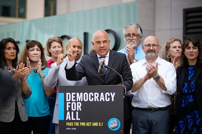 Surrounded by Democratic members of the Texas Legislature, state Rep. Chris Turner, chair of the Texas House Democratic Caucus, speaks during a news conference outside the AFL-CIO headquarters Thursday in Washington. The organized labor advocates called for the U.S. Senate to repeal the filibuster to allow passage of several bills they support, including the For the People Act and the John Lewis Voting Rights Act.