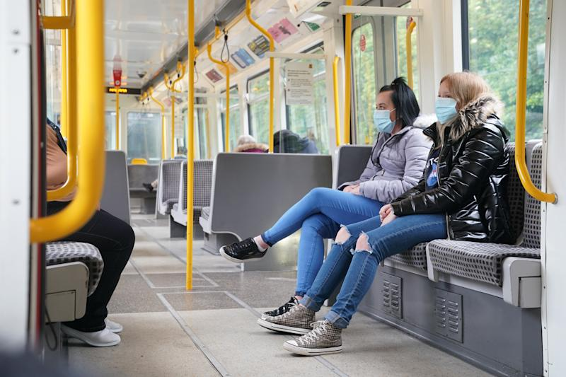 Passengers wearing face masks on a train in Newcastle as face coverings become mandatory on public transport in England with the easing of further lockdown restrictions during the coronavirus pandemic. (Photo by Owen Humphreys/PA Images via Getty Images)