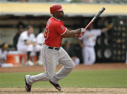 Los Angeles Angels' Torii Hunter swings for a two-run single off Oakland Athletics' Grant Balfour in the ninth inning of a baseball game on Wednesday, Sept. 5, 2012, in Oakland, Calif. (AP Photo/Ben Margot)